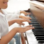 child playing piano as part of music therapy with WAFTalks